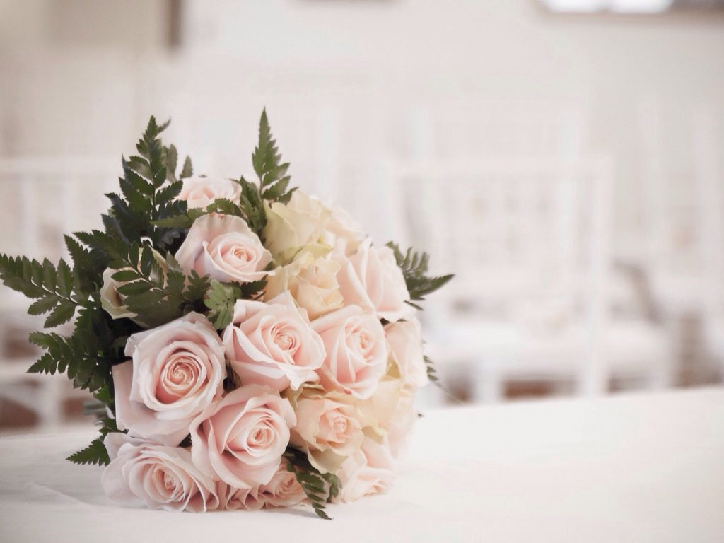 bouquet of roses on table at wedding 683866307 5a8207778023b90037a1f946 1024x768 - How Beautiful Flowers Can Make Your Wedding More Unforgettable