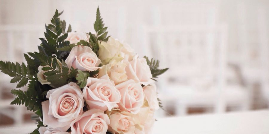 bouquet of roses on table at wedding 683866307 5a8207778023b90037a1f946 900x450 - How Beautiful Flowers Can Make Your Wedding More Unforgettable